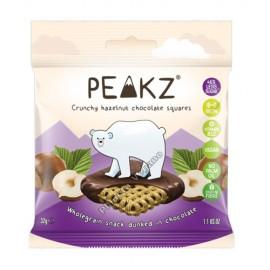 Cuadraditos de Grano Integral Recubiertos con Chocolate de Avellana, 32g. Peakz